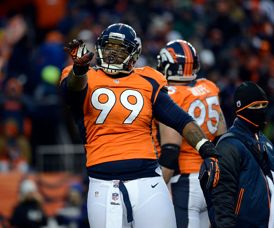 . Denver Broncos defensive tackle Kevin Vickerson (99) celebrates on the field during the second half.  The Denver Broncos vs Baltimore Ravens AFC Divisional playoff game at Sports Authority Field Saturday January 12, 2013. (Photo by Tim Rasmussen,/The Denver Post)