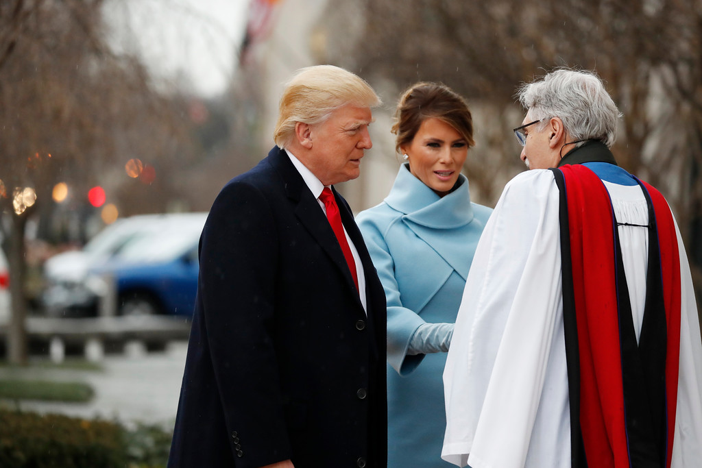 . Rev. Luis Leon greets President-elect Donald Trump and his wife Melania as they arrive for a church service at St. John�s Episcopal Church across from the White House in Washington, Friday, Jan. 20, 2017, on Donald Trump\'s inauguration day. (AP Photo/Alex Brandon)