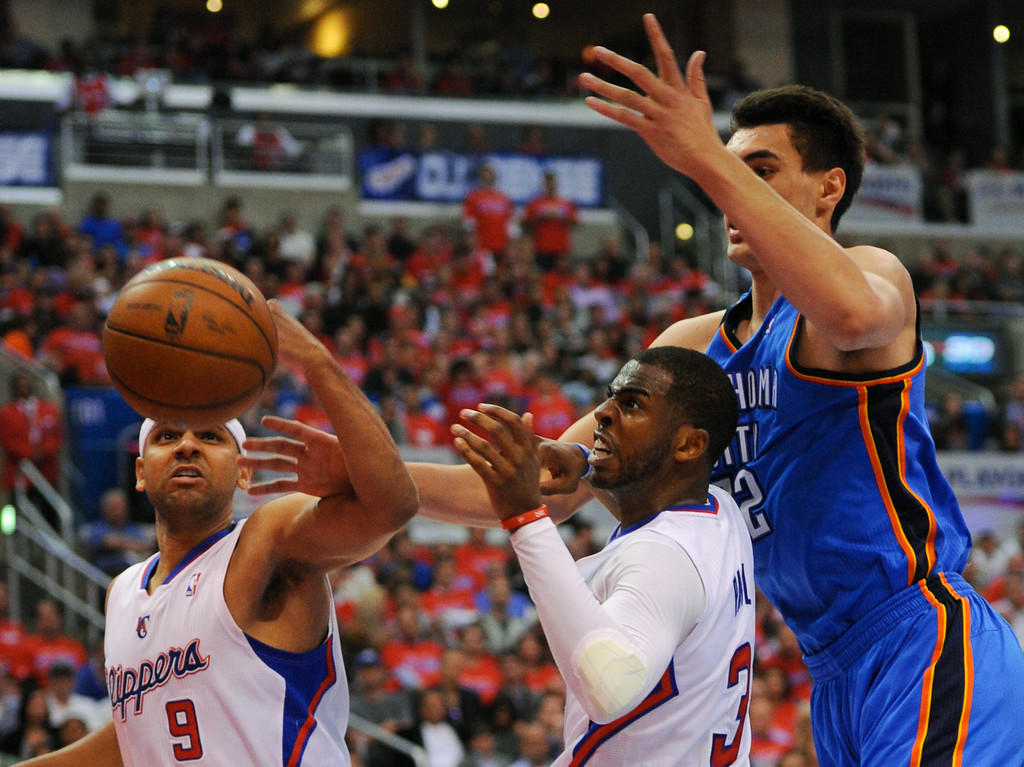 . Clippers\' Jared Dudley, left, and Chris Paul box out Steven Adams from a ball going out of bounds, Friday, May 9, 2014, at Staples Center. (Photo by Michael Owen Baker/Los Angeles Daily News)