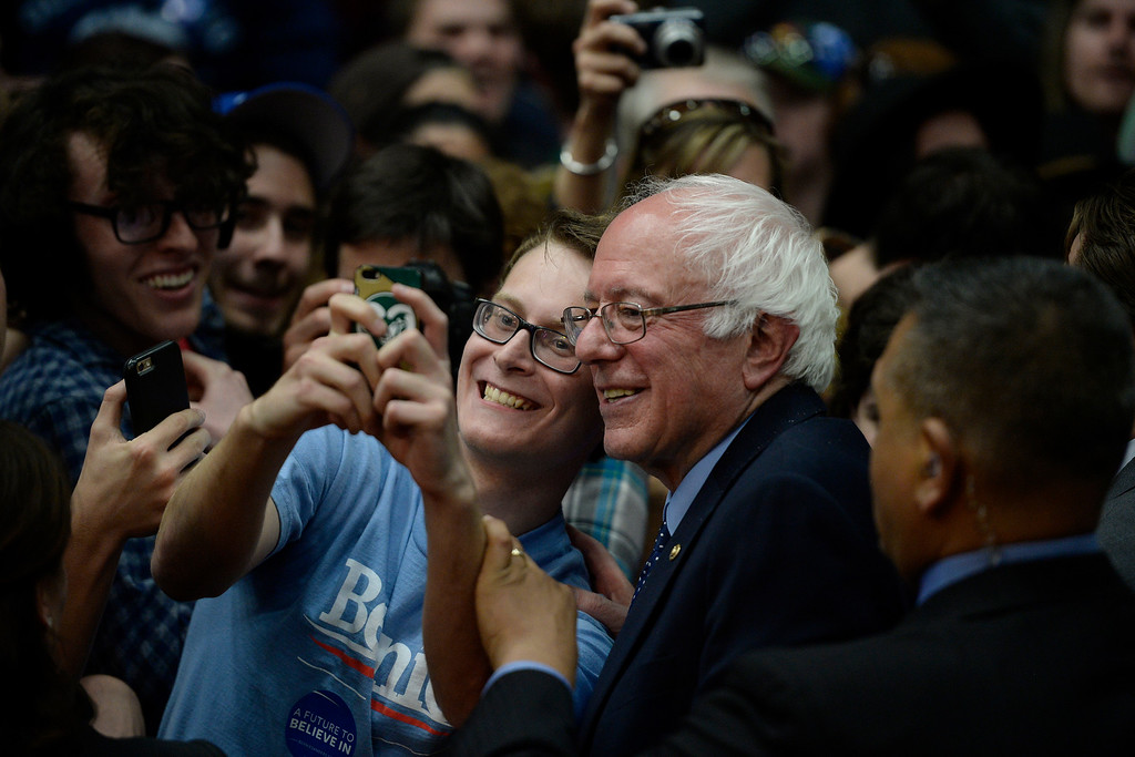 . FORT COLLINS, CO - FEBRUARY 28: Bernie Sanders takes a selfie with a young supporter during a rally at Colorado State University\'s Moby Arena on Sunday, February 28, 2016. (Photo by AAron Ontiveroz/The Denver Post)