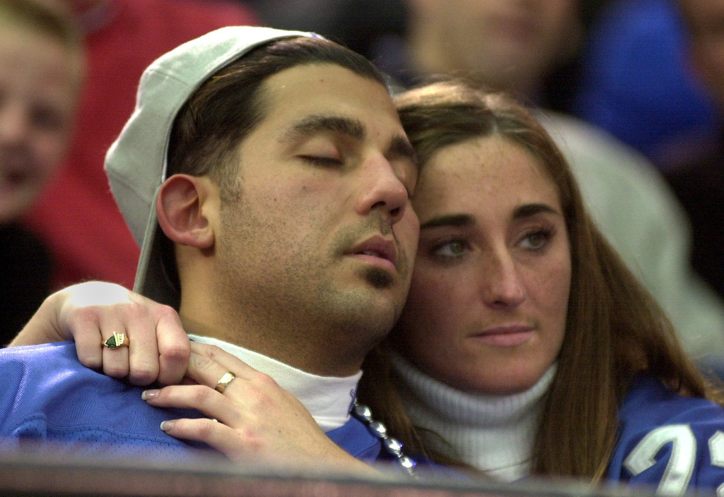 . Nick Bondarek takes a nap while Tammy Johns, both of Port Huron, watch the Detroit Lions lose to the Tampa Bays Buccaneers 20-17 at the Pontiac Silverdome Sunday.