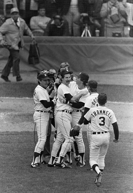 . Winning Detroit Tigers pitcher Jack Morris is all smiles Saturday, Oct. 13, 1984 hugged by Detroit teammates after lasting nine innings in the Tigers\' 4-2 win over San Diego in game four of the World Series. Tigers are Dave Bergman, left, Darrell Evans, Tom Brookens and Alan Trammell who hit two home runs. (AP Photo/ Ron Heflin)