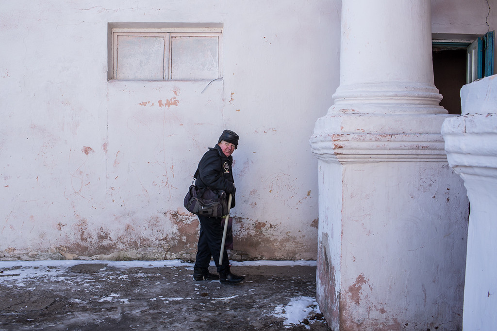 . MYRONIVSKYI, UKRAINE - FEBRUARY 17: A man outside the local House of Culture, which serves as a distribution point for humanitarian aid and provides a bomb shelter, on February 17, 2015 in Myronivskyi, Ukraine. A ceasefire agreed to by Ukraine and pro-Russian rebel forces has failed to prevent fighting in the nearby town of Debaltseve, where thousands of Ukrainian troops remain and whom rebels claim to have surrounded. (Photo by Brendan Hoffman/Getty Images)