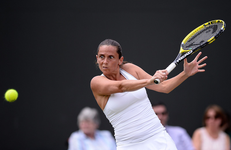 . Roberta Vinci of Italy plays a backhand during her Ladies\' Singles fourth round match against Na Li of China on day seven of the Wimbledon Lawn Tennis Championships at the All England Lawn Tennis and Croquet Club on July 1, 2013 in London, England.  (Photo by Dennis Grombkowski/Getty Images)