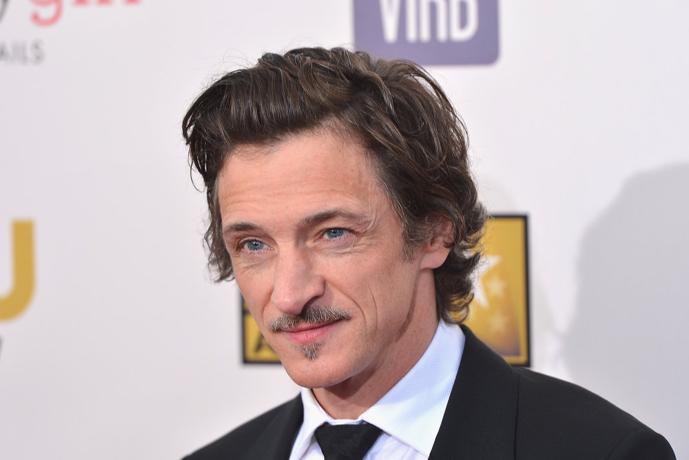 Description of . Actor John Hawkes arrives at the 18th Annual Critics' Choice Movie Awards at Barker Hangar on January 10, 2013 in Santa Monica, California.  (Photo by Frazer Harrison/Getty Images)