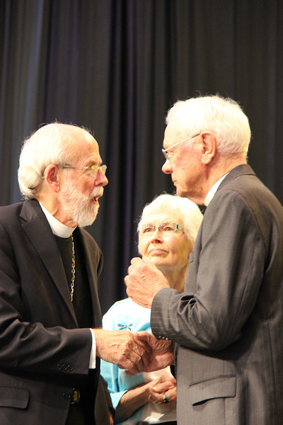 The Rev. Herbert Chilstrom, first/former presiding bishop of the ELCA, and his wife the Rev. E. Corine Chilstrom speak with Presiding Bishop Mark S. Hanson.