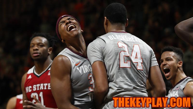 Zach Leday (32), Kerry Blackshear Jr (24) and Seth Allen (right) celebrate after a Virginia Tech basket and foul in overtime. (Mark Umansky/TheKeyPlay.com)