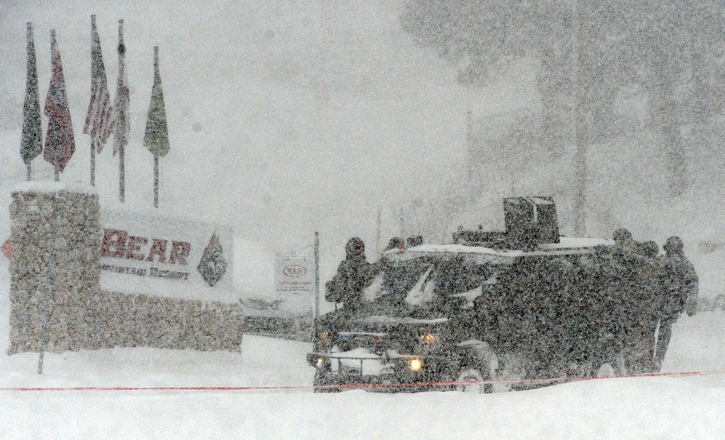 . (Will Lester/Staff Photographer)  A San Bernardino County Sheriff SWAT team returns to the command post at Bear Mountain in Big Bear after searching for Christopher Jordan Dorner Friday February 8, 2013. Search conditions have been hampered as a heavy winter storm has hit the area.