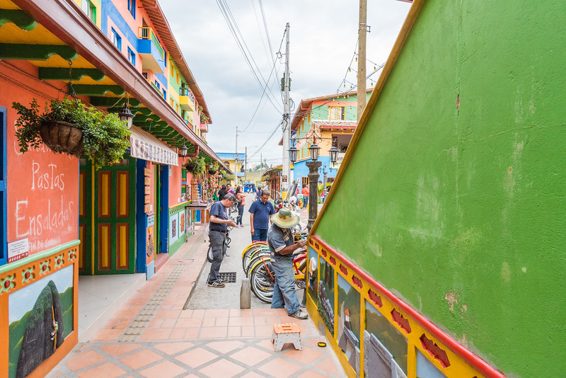 Workmen maintaining the beautiful coloured streets of Guatape