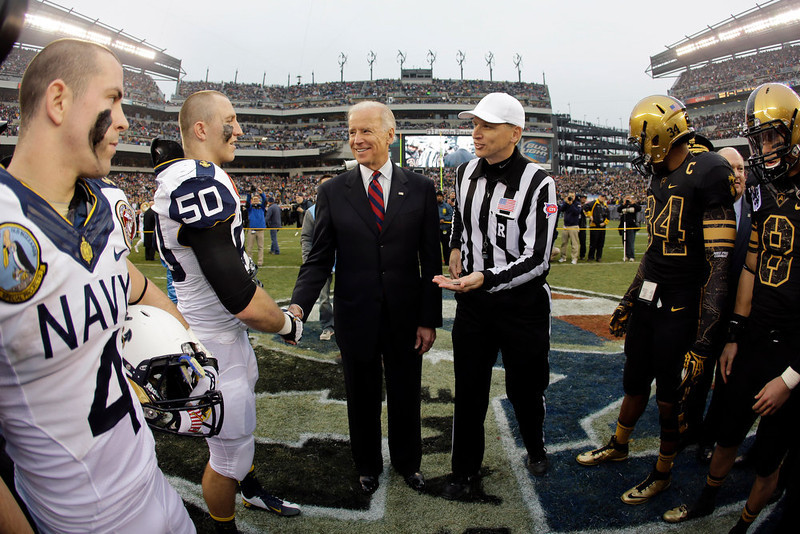 . Vice President Joe Biden, center, greets Navy\'s Brye French before the coin toss before an NCAA college football game against Army, Saturday, Dec. 8, 2012, in Philadelphia. (AP Photo/Matt Slocum)