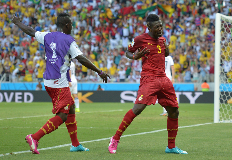 . Ghana\'s forward and captain Asamoah Gyan (R) celebrates after scoring during a Group G football match between Germany and Ghana at the Castelao Stadium in Fortaleza during the 2014 FIFA World Cup on June 21, 2014.  (CARL DE SOUZA/AFP/Getty Images)