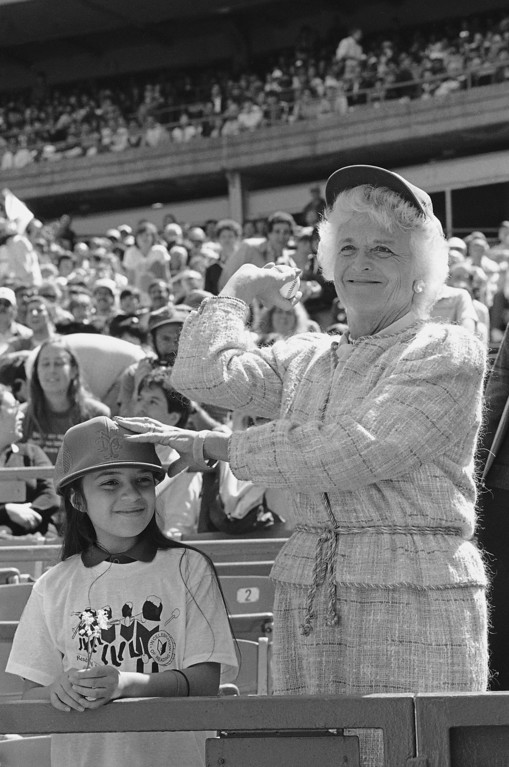. Mrs. Barbara Bush, wife of Vice-President George Bush, throws out the first ball, Saturday, April 27, 1985  during a Mets vs. Pirates Baseball game at Shea Stadium in New York. She was there as a member of RIF, Reading is Fundamental, program board of directors. At her side is nine-year-old Mayra Martinez, the New York City RIF Reader. (AP Photo/G. Paul Burnett)