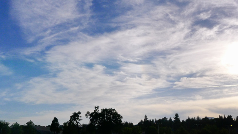 Light clouds in sky during final phase of the annular eclipse.