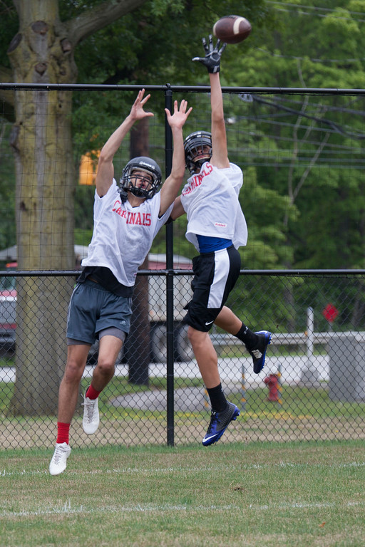 . Jen Forbus - The Morning Journal<br> Brookside players leap for the ball during drills on Brookside\'s first day of football practice on July 30.