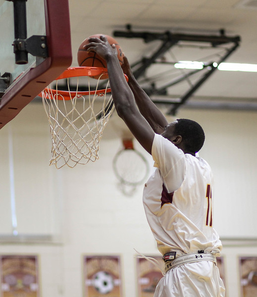 """February 2, 2019: McNamra center Favour Aire (11) dunks the ball during HS boys basketball action between Bishop O'Connell HS and Bishop McNamara HS in Forestville. Photo by: Chris Thompkins/Prince George""""s Sentinel"""