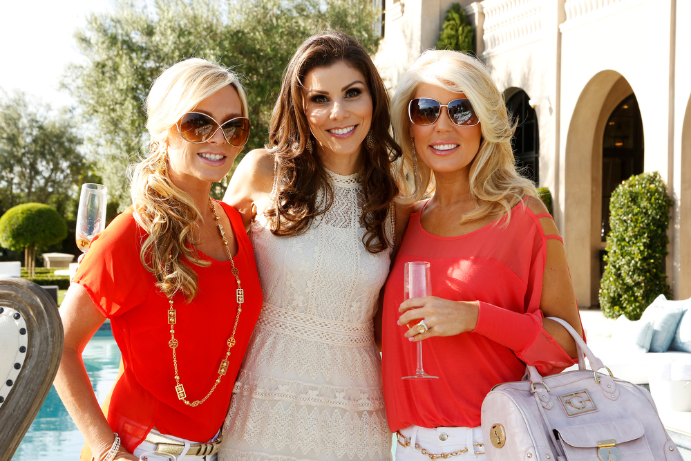 ". REAL HOUSEWIVES OF ORANGE COUNTY -- ""All Housewives Clam Bake at Rachel\'s\"" -- Pictured: (l-r) Tamra Barney, Heather Dubrow, Gretchen Rossi -- (Photo by Vivian Zink/Bravo)"