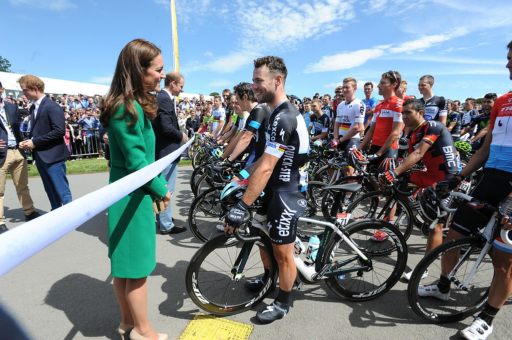 . LEEDS, ENGLAND - JULY 5:  Catherine, Duchess of Cambridge talks to Mark Cavendish of Omega Pharma-Quick Step before the start of the start of the Tour de France on July 5, 2014 at West Tanfield, Yorkshire, England.  (Photo by Asadour Guzelian - WPA Pool/Getty Images)