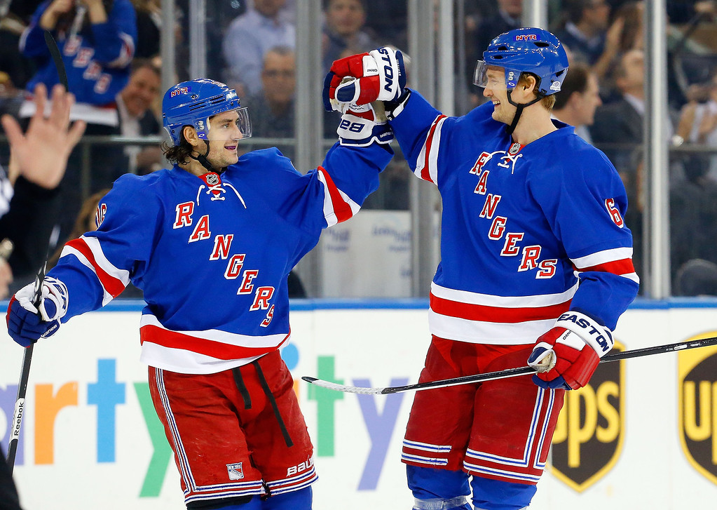 . Anton Stralman #6 of the New York Rangers celebrates his second-period goal against the Colorado Avalanche with teammate Mats Zuccarello #36 at Madison Square Garden on February 4, 2014 in New York City.  (Photo by Jim McIsaac/Getty Images)