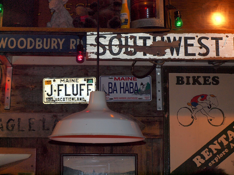 Signs inside Rupununi American Bar and Grill in Bar Harbor