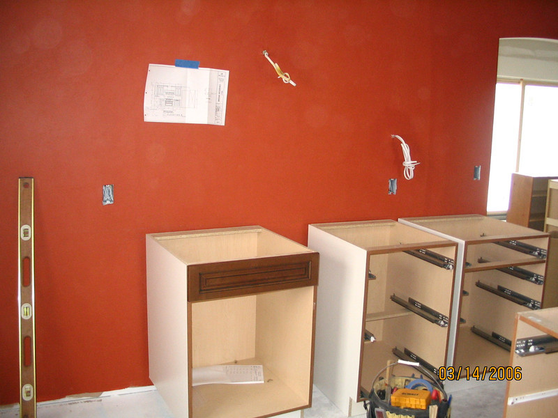 This wall will be where the cooktop is; the living room sliding doors can be seen on the far right.