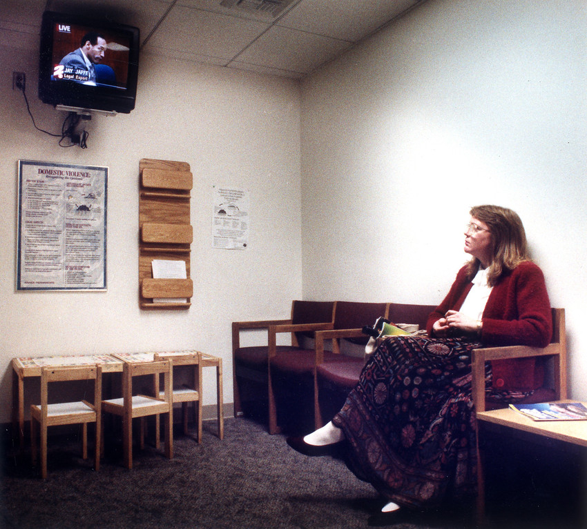. Erika Becker watches the proceedings in the O.J. Simpson trial at the Kaiser Permanente Hospital in Woodland Hills.   (1/23/95)   (Los Angeles Daily News file photo)