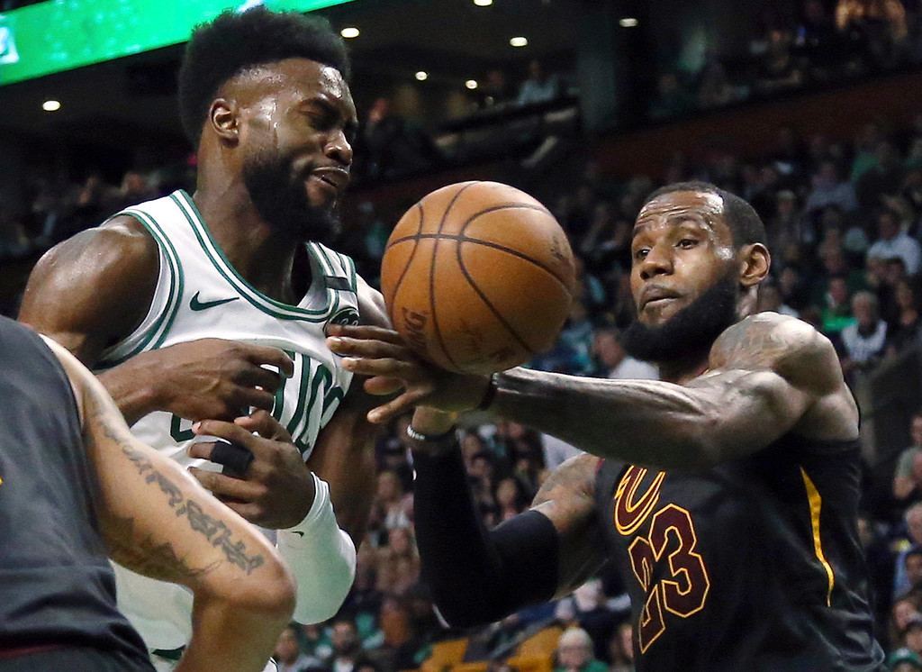 . Boston Celtics guard Jaylen Brown, left, loses the ball as Cleveland Cavaliers forward LeBron James defends during the second half in Game 7 of the NBA basketball Eastern Conference finals, Sunday, May 27, 2018, in Boston. (AP Photo/Elise Amendola)