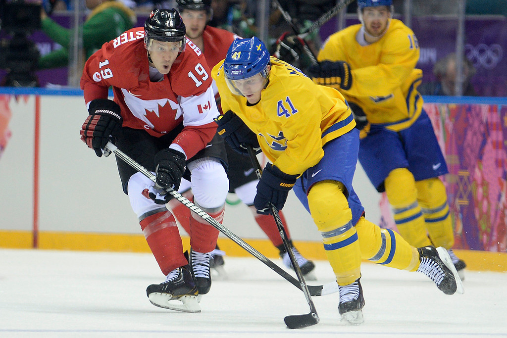 . Gustav Nyquist (41) of Sweden controls the puck as Jay Bouwmeester (19) of Canada pursues during the third period of Canada\'s 3-0 win in the men\'s ice hockey gold medal game against Sweden. Sochi 2014 Winter Olympics on Sunday, February 23, 2014 at Bolshoy Ice Arena. (Photo by AAron Ontiveroz/ The Denver Post)