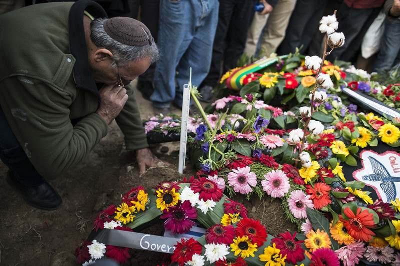 . Mourners place flowers and pay their last respects to former Prime Minister Ariel Sharon during his funeral at Havat Hashikmim on January 13, 2014 in Israel. Former PM Ariel Sharon\'s died on Saturday aged 85 in Tel Hashomer hospital near Tel Aviv and had been in a coma since January 4, 2006.  (Photo by Ilia Yefimovich/Getty Images)