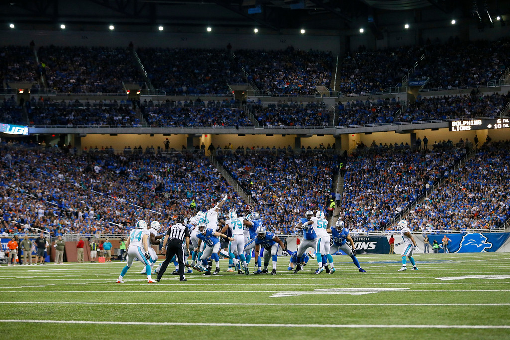 . The Miami Dolphins block a field goal by Detroit Lions kicker Matt Prater during the second half of an NFL football game in Detroit, Sunday, Nov. 9, 2014. (AP Photo/Rick Osentoski)