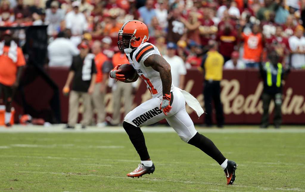 . Cleveland Browns cornerback Jamar Taylor (21) runs with his interception during the first half of an NFL football game against the Washington Redskins, Sunday, Oct. 2, 2016, in Landover, Md. (AP Photo/Chuck Burton)