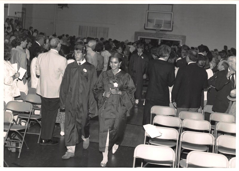 Graduation '86. Apparently it rained that year. Karyn Bryant and Todd Wheelden in front.