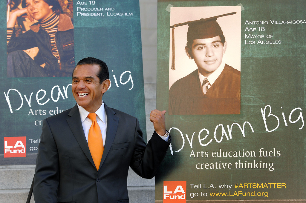 ". Mayor Antonio Villaraigosa points to a young picture of himself that will be used on billboards as part of the second phase of ""Arts Matter.\""  (Michael Owen Baker/L.A. Daily News)"