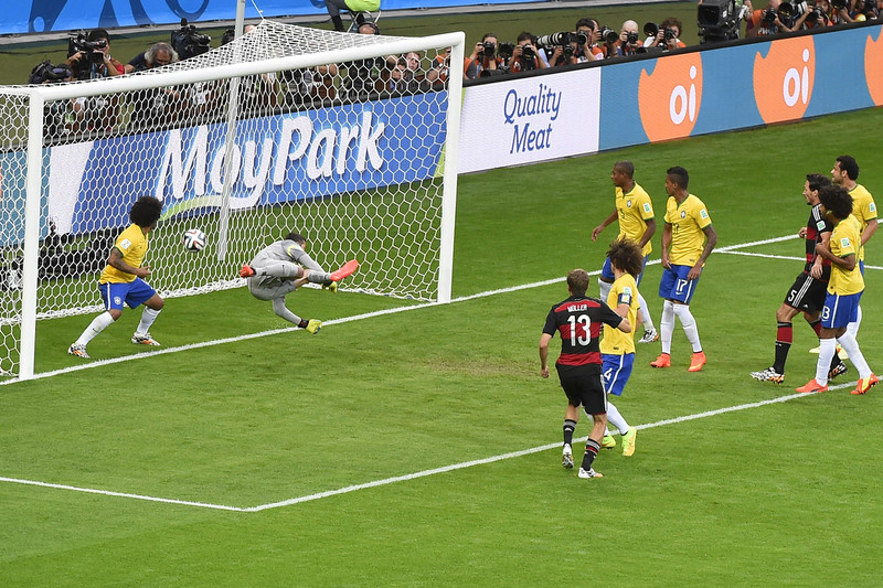 . Germany\'s forward Thomas Mueller (3L) scores during the semi-final football match between Brazil and Germany at The Mineirao Stadium in Belo Horizonte during the 2014 FIFA World Cup on July 8, 2014. (ODD ANDERSEN/AFP/Getty Images)