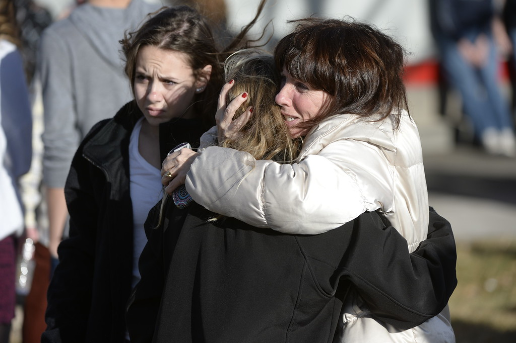 . CENTENNIAL, CO. - DECEMBER 13: Families are reunited at a Burger King near Arapahoe High School in Centennial, CO December 13, 2013. A student who carried a shotgun into Arapahoe High School and asked where to find a specific teacher opened fire on Friday, wounding two fellow students before apparently killing himself, Arapahoe County Sheriff Grayson Robinson said. (Photo By Craig F. Walker / The Denver Post)