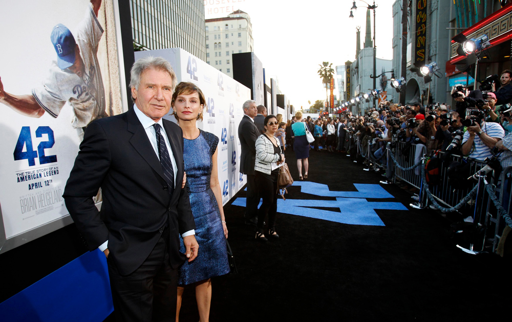 ". Cast member Harrison Ford and his wife actress Calista Flockhart pose at the premiere of ""42\"" in Hollywood, California April 9, 2013. The movie opens in the U.S. on April 12.  REUTERS/Mario Anzuoni"