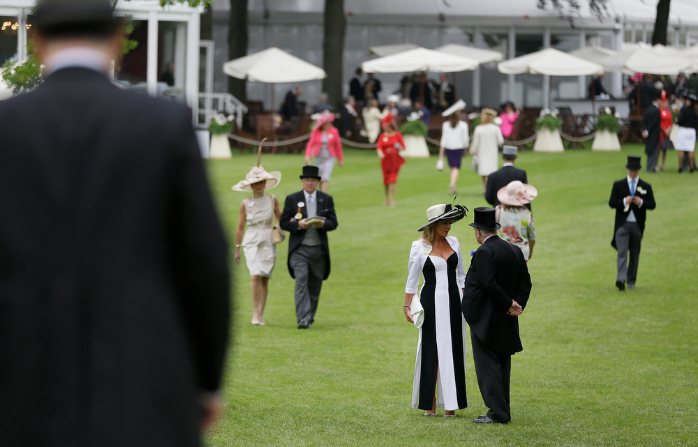 . Jenny Hammond-Ediss and Alan Ediss talk together in the Royal Enclosure on the first day of the Royal Ascot horse race meeting in Ascot, England, Tuesday, June 18, 2013. (AP Photo/Alastair Grant)