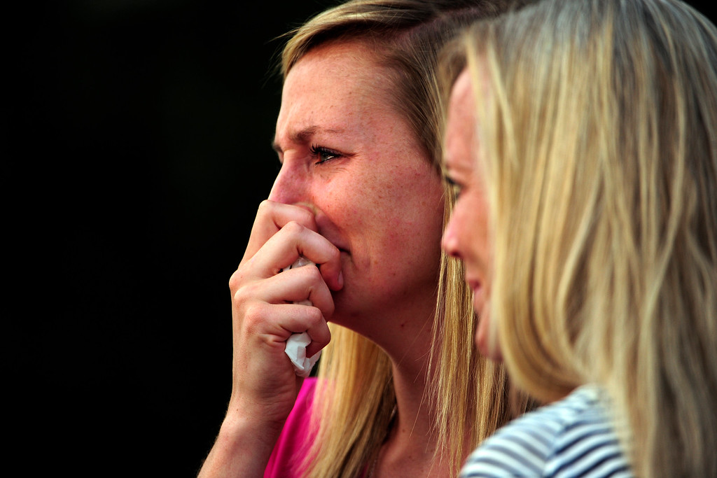 . Amanda Lindgren, girlfriend of Alex Teves who was killed, cries during a community vigil held in honor of the victims of the Aurora theater shooting at the Aurora Municipal Center on Sunday, July 22, 2012. AAron Ontiveroz, The Denver Post