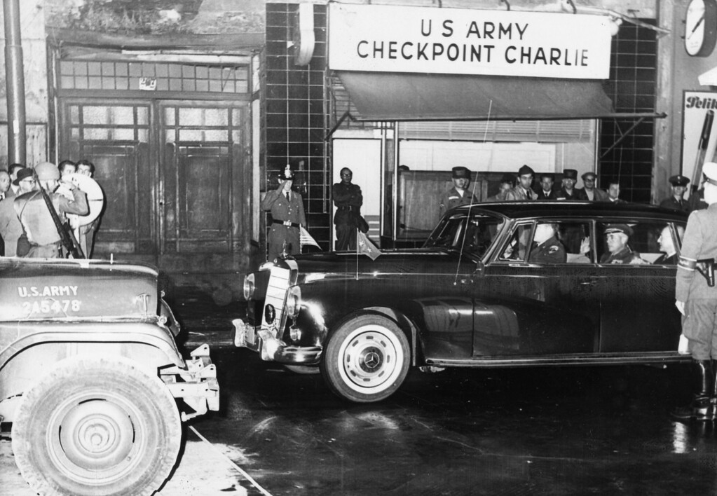 . Military personnel in a car pass through the US Army\'s Checkpoint Charlie on the Berlin Wall, circa 1962.  (Photo by Keystone/Getty Images)