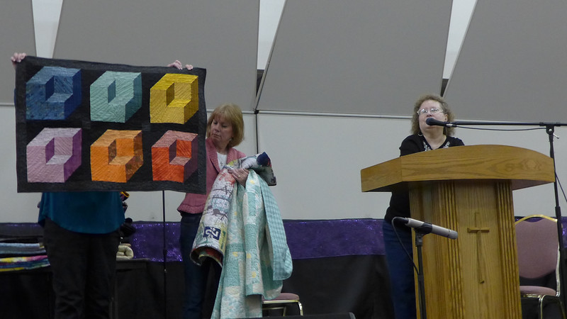 Our president Janet Keesler, showing us a quilt that began in the Karen Combs class sponsored by the guild.