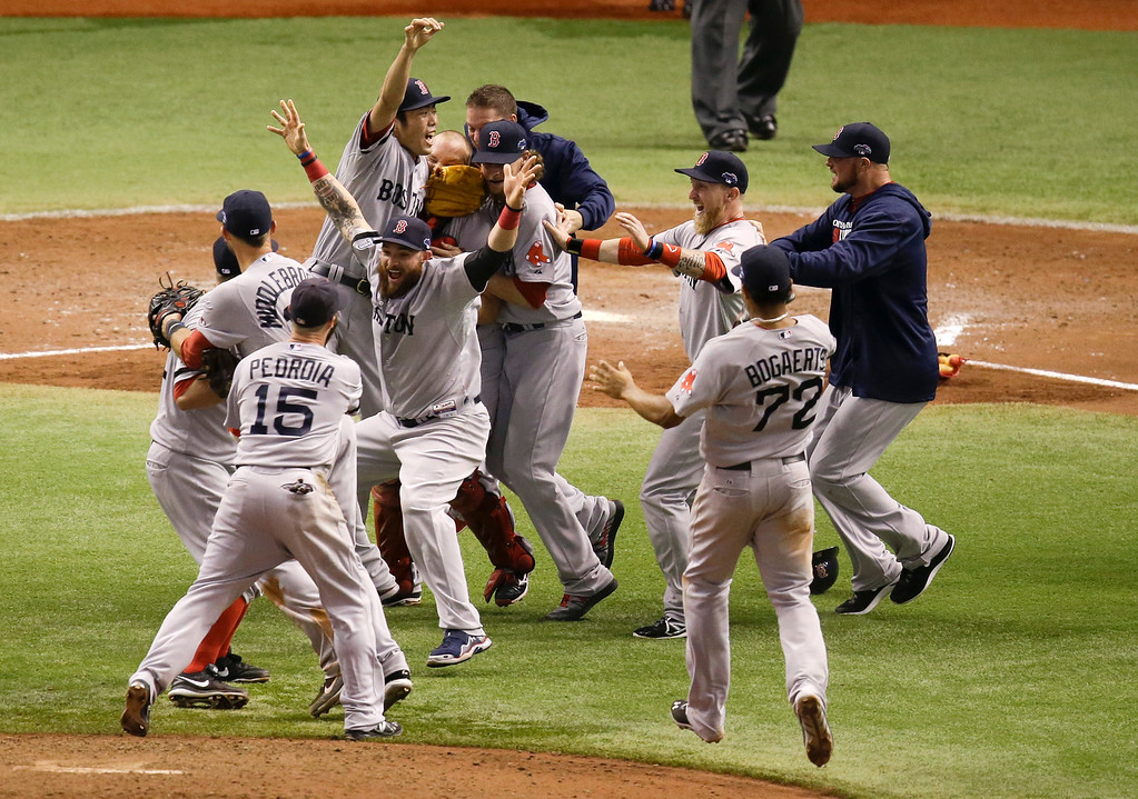 . Boston Red Sox players celebrate after defeating the Tampa Bay Rays 3-1 to win  baseball\'s American League division series, Tuesday, Oct. 8, 2013, in St. Petersburg, Fla. (AP Photo/John Raoux)
