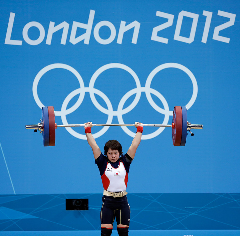 . FILE - In this July 28, 2012 file photo, Japanese weightlifter Hiromi Miyake competes on her way to winning the silver medal in the women\'s 48kg weightlifting at the 2012 Summer Olympic in London. The Olympics are in Miyake\'s blood, a heritage that stretches back to the 1960s, when her uncle won a gold medal at the 1964 Tokyo Games and her father won bronze in Mexico City in 1968. With the Olympics coming to Tokyo in 2020, she hopes that will inspire the next generation of Japanese athletes. (AP Photo/Hassan Ammar, File)