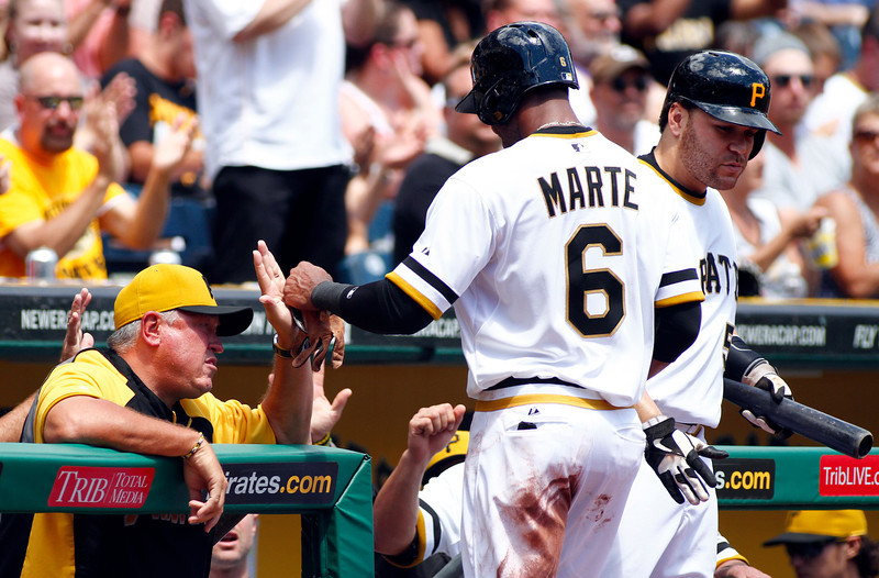 . Starling Marte #6 of the Pittsburgh Pirates celebrates after scoring on an RBI single in the first inning against the Colorado Rockies during the game on August 4, 2013 at PNC Park in Pittsburgh, Pennsylvania.  (Photo by Justin K. Aller/Getty Images)