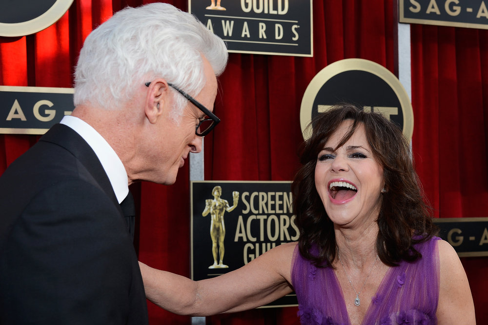 . Actor John Slattery (L) and actress Sally Field arrive at the 19th Annual Screen Actors Guild Awards held at The Shrine Auditorium on January 27, 2013 in Los Angeles, California.  (Photo by Kevork Djansezian/Getty Images)
