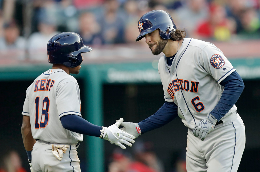 . Houston Astros\' Jake Marisnick (6) is congratulated by Tony Kemp after Marisnick hit a three-run home run in the sixth inning of a baseball game against the Cleveland Indians, Thursday, May 24, 2018, in Cleveland. (AP Photo/Tony Dejak)
