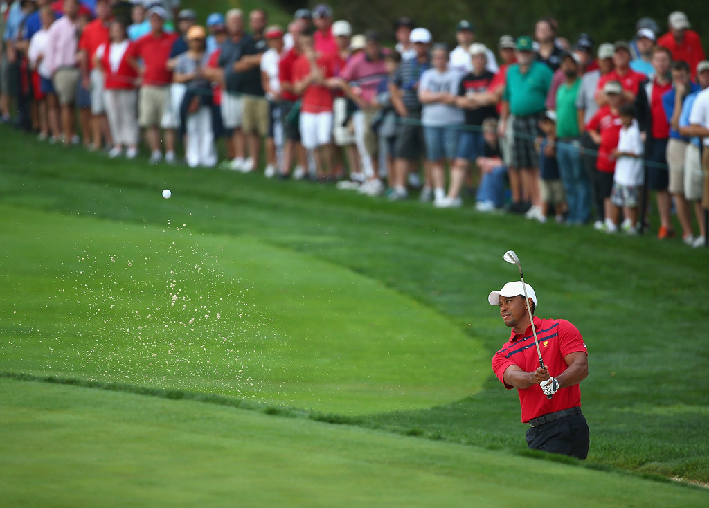 . DUBLIN, OH - OCTOBER 05:  Tiger Woods of the U.S. Team hits his third shot on the first hole during the Day Three Four-ball Matches at the Muirfield Village Golf Club on October 5, 2013  in Dublin, Ohio.  (Photo by Andy Lyons/Getty Images)