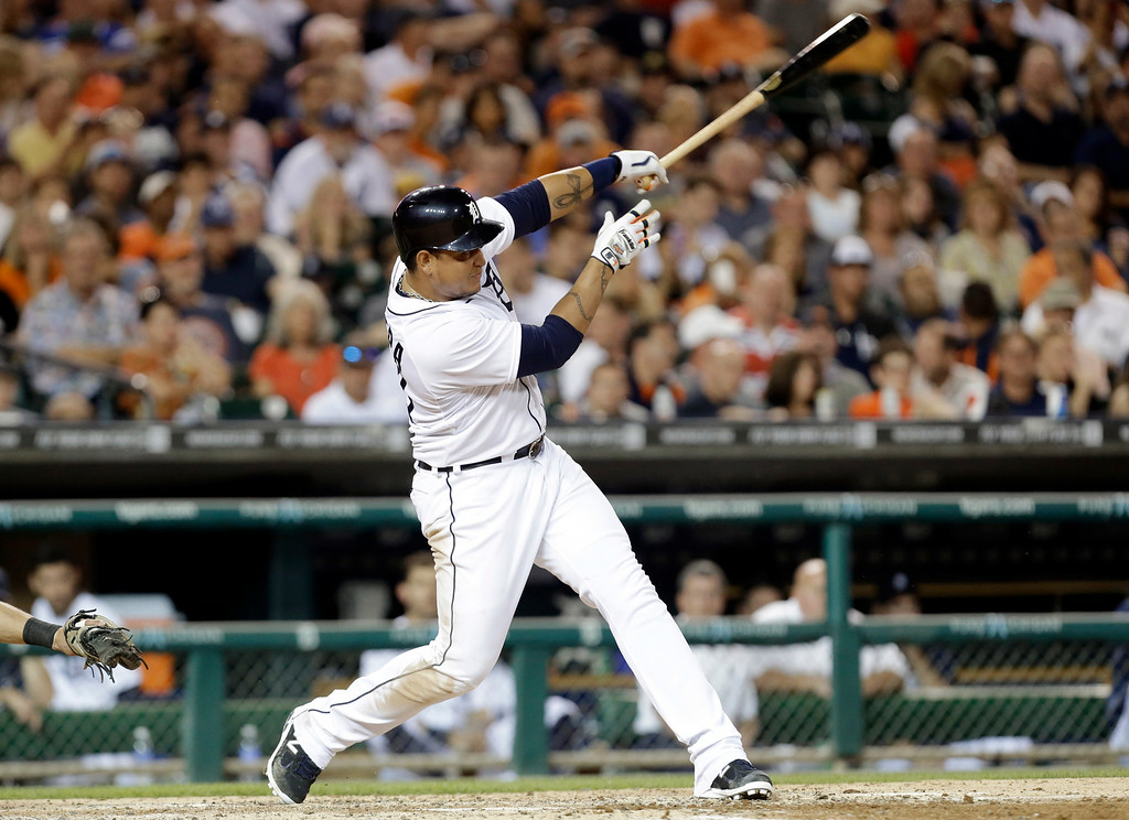 . Detroit Tigers\' Miguel Cabrera hits a one-run double against the New York Yankees in the fourth inning of a baseball game in Detroit, Wednesday, Aug. 27, 2014. (AP Photo/Paul Sancya)