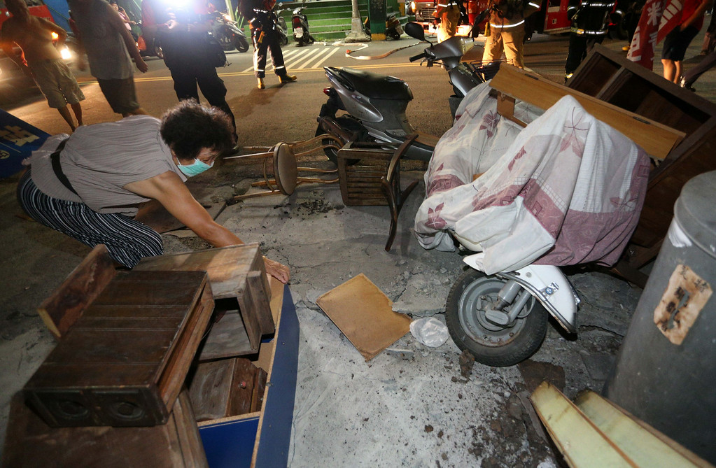 . An old woman moves a furniture at the outside on July 31, 2014 in Kaohsiung, Taiwan of China. 800 soldiers participated in the rescue efforts after a gas pipeline exploded killing 20 (5 firemen), injuring 290 and destroying 4 firetrucks.  (Photo by ChinaFotoPress/ChinaFotoPress via Getty Images)