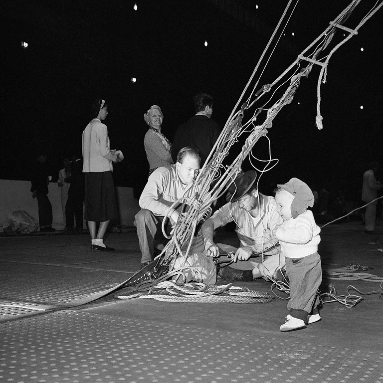 . Ten-month-old Roland Bischoff seems a bit beside himself as he gets a line on circus doings in New York�s Madison Square Garden on March 26, 1959. His parents are Horst and Globe Bischoff, a springboard duo with acrobatic performing in the Ringling Brothers, Barnum and Bailey Circus. (AP Photo/John Lindsay)