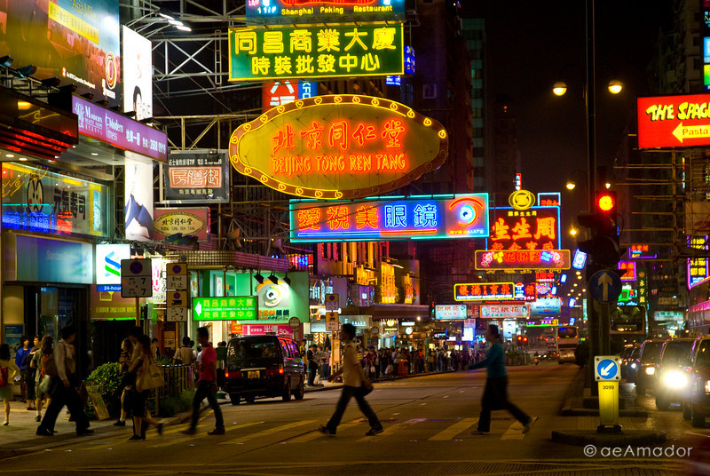 aeamador©-HK08_DSC0173      Hong Kong. Kowloon. Tsim Sha Tsui. Though not to be compared with what you find in Hong Kong island, it is quite a vibrant and lively city. People fill up the streets and sidewalks day and night for shopping, entertainment and more. Signs make a great show, especially at night, giving vibrancy and character to the city. The Beatles?
