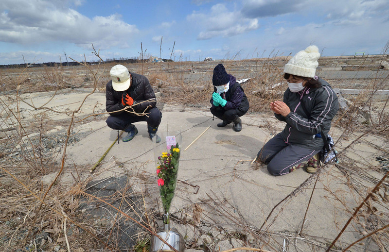 . Relatives of tsunami victims offer prayers at the site of their house that was swept by tsunami at Namie, near the striken TEPCO\'s Fukushima Dai-ichi nuclear plant in Fukushima prefecture on March 11, 2014 on the third anniversary day of massive earthquake and tsunami hit northern Japan. The 9.0 magnitude earthquake in 2011 sent a huge wall of water into the coast of the Tohoku region, splintering whole communities, ruining swathes of prime farmland and killing nearly 19,000 people. (YOSHIKAZU TSUNO/AFP/Getty Images)